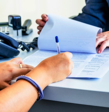Employee-signing-paper